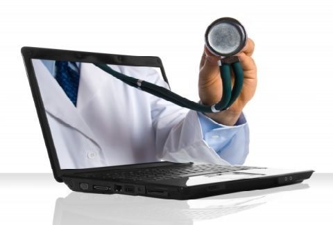 hand holding stethoscope coming out of laptop screen reflects how telemedicine and original medicare work